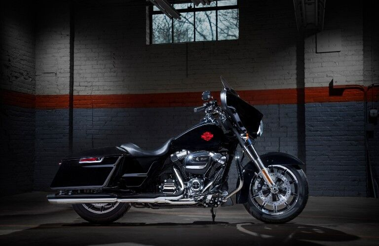 The side view of a black 2019 Harley-Davidson Electra Glide.