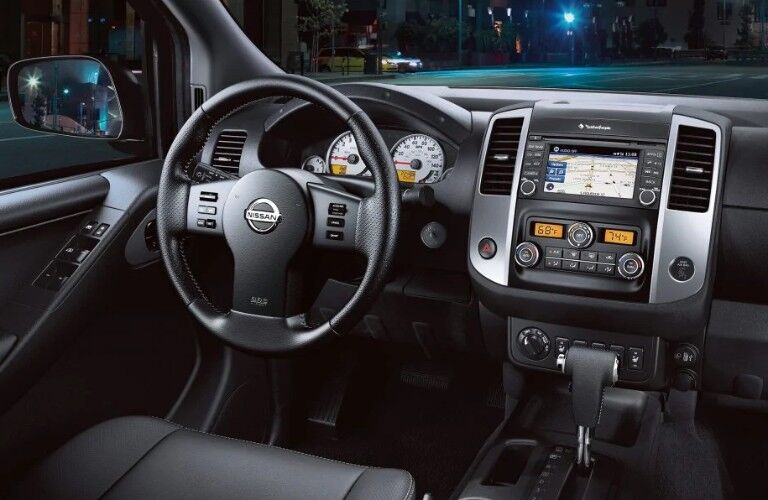 Steering wheel and touchscreen inside the 2019 Nissan Frontier