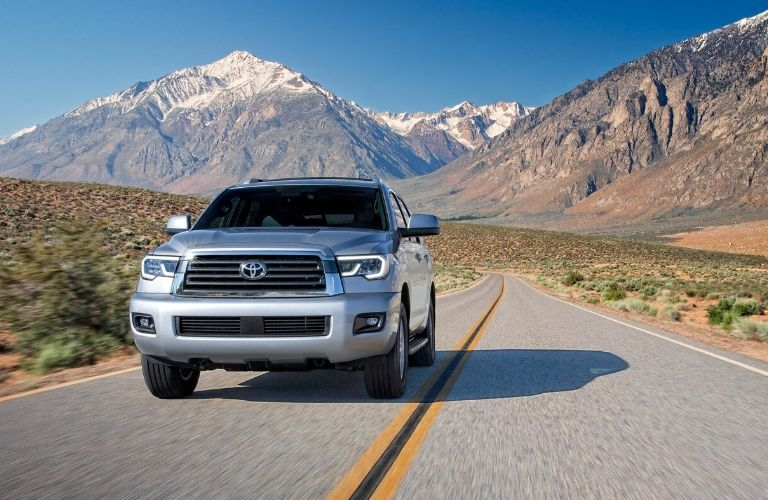 2020 Toyota Sequoia driving on highway away from mountains