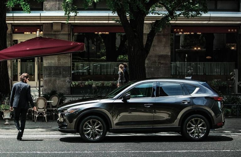 Exterior view of the driver's side of a gray 2020 Mazda CX-5