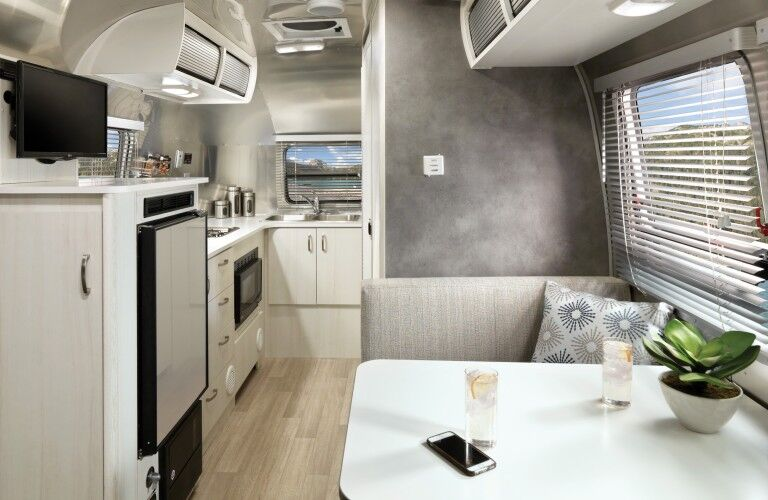 The interior inside a 2020 Airstream Bambi, which has multiple appliances inside.