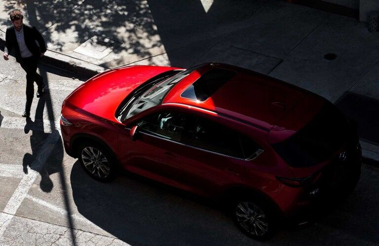 Overhead view of red 2019 Mazda CX-5 with man walking next to it