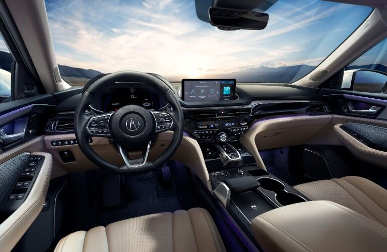 A photo of the dashboard and driver's cockpit in the 2022 Acura MDX.
