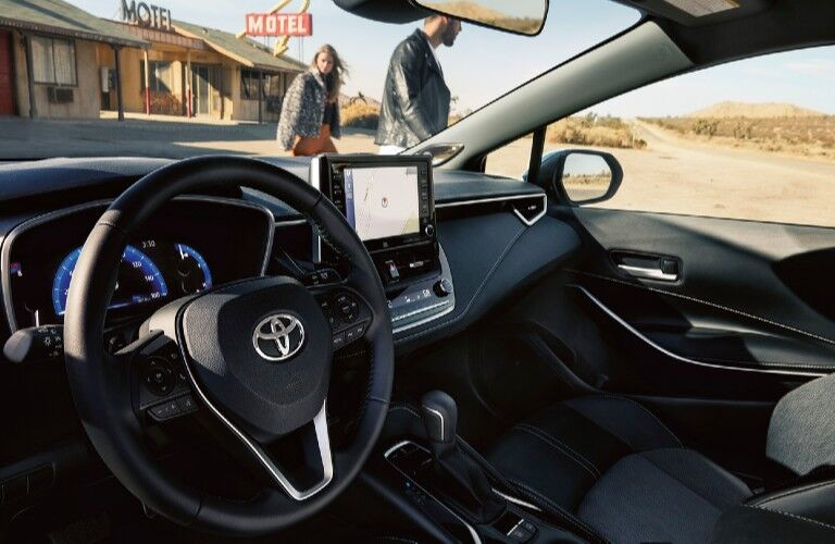 Interior view of the front seating area inside a 2020 Toyota Corolla Hatchback