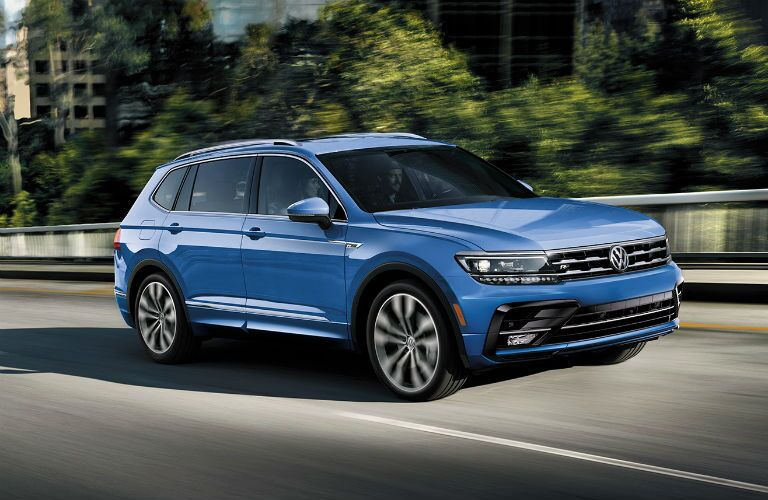 blue vw tiguan driving on the road near topeka