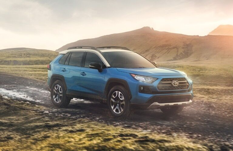 Front passenger angle of a blue 2020 Toyota RAV4 parked outdoors