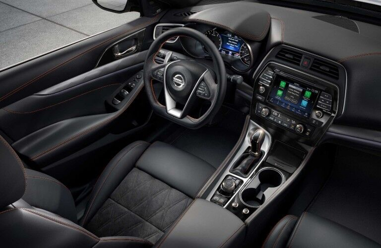 Passenger aerial angle of the steering wheel and driver seat inside the 2020 Nissan Maxima