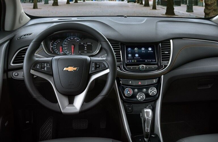 Close up of the steering wheel and dashboard inside the 2020 Chevrolet Trax