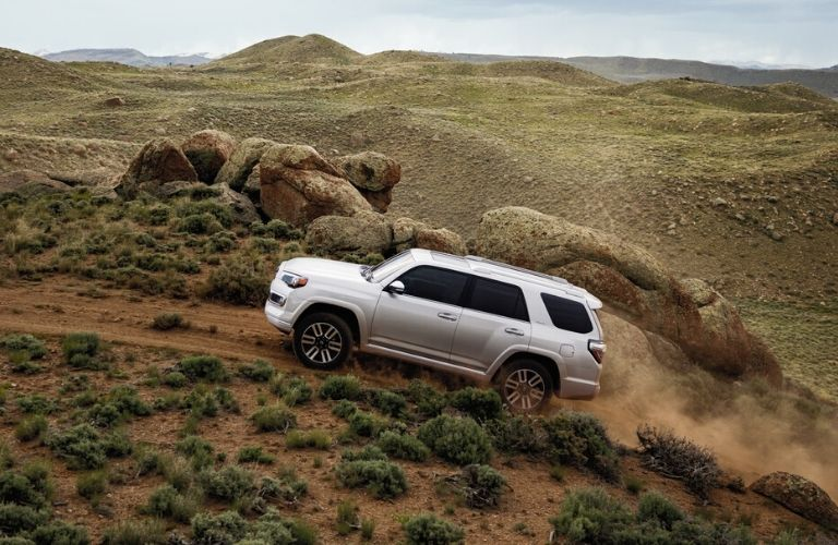 white 2020 Toyota 4Runner driving up a hill