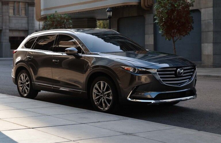 Front passenger angle of a grey 2019 Mazda CX-9 parked on the side of a street