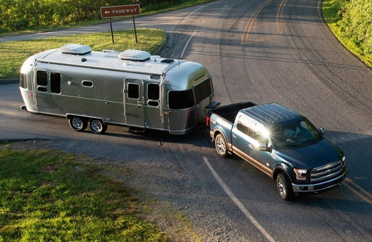 Exterior view of a 2020 Airstream Flying Cloud towed by a pickup truck