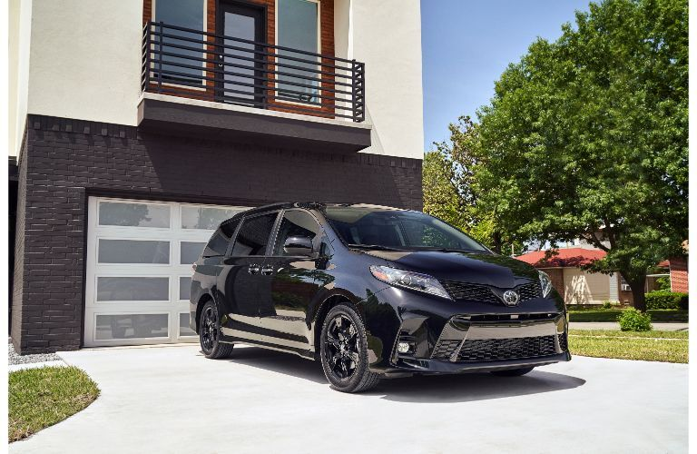 2020 Toyota Sienna Nightshade Edition exterior shot parked outside of a garage on the driveway of a luxury suburban home