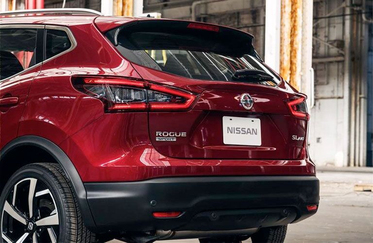 Passenger's side rear angle view of red 2020 Nissan Rogue Sport