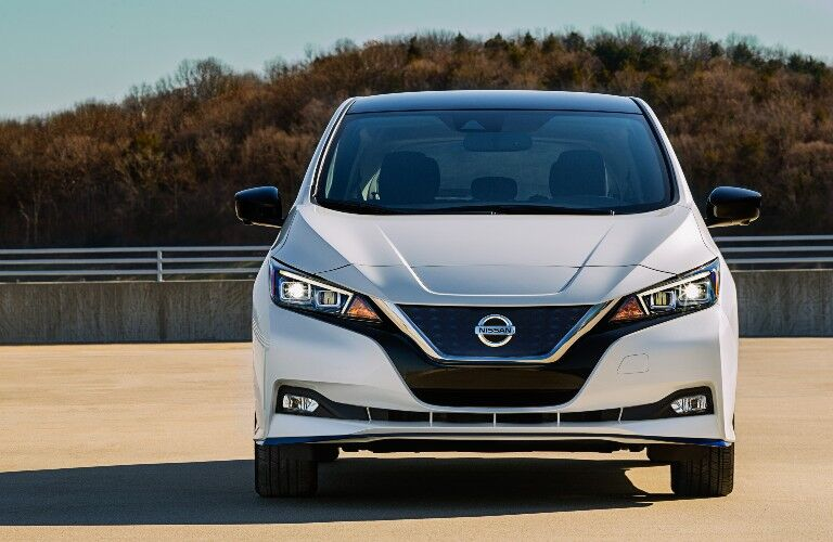 The front side of a white 2021 Nissan Leaf.