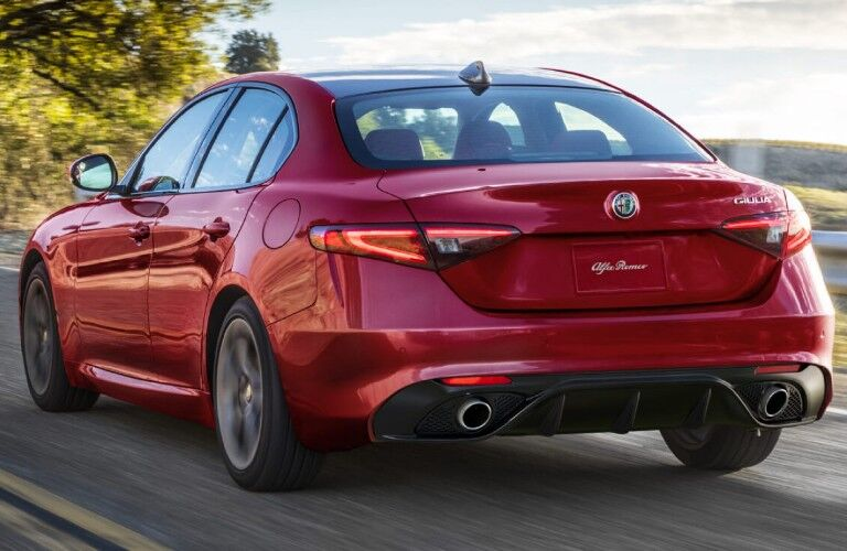 Rear driver angle of a red 2020 Alfa Romeo Giulia