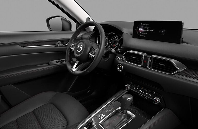 The front interior inside a 2021 Mazda CX-5 Carbon Edition trim.