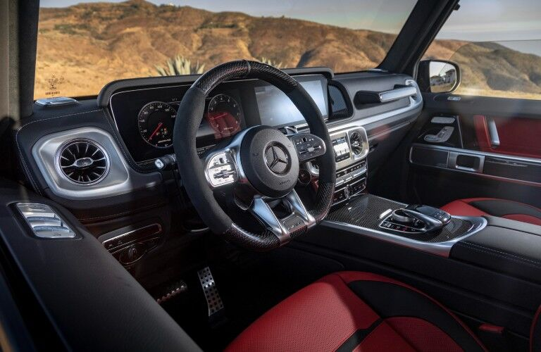A photo of the driver's cockpit in the 2021 Mercedes-Benz G-Class SUV.