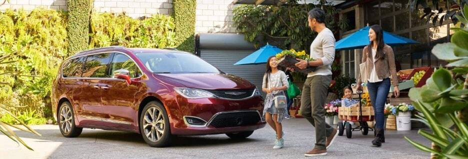 Family going flower shopping with their red Chrysler Pacifica