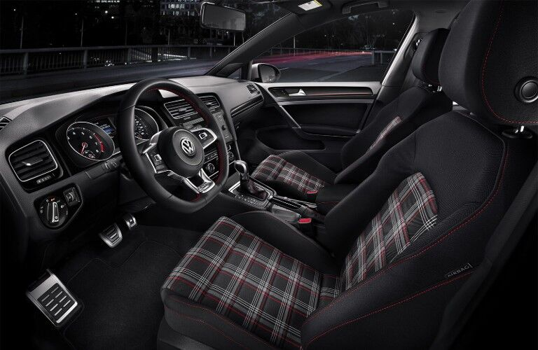 Driver angle of the front row seats with Clark Plaid cloth in the 2019 Volkswagen Golf GTI