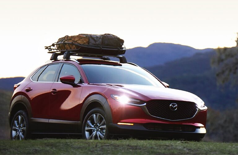 The front view of a red 2021 Mazda CX-30 with a cargo space on its top.