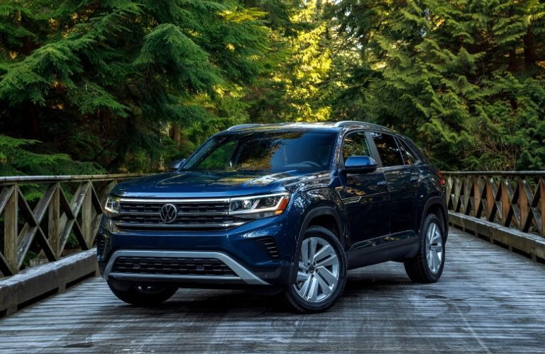 Exterior view of the front of a blue 2020 Volkswagen Atlas Cross Sport