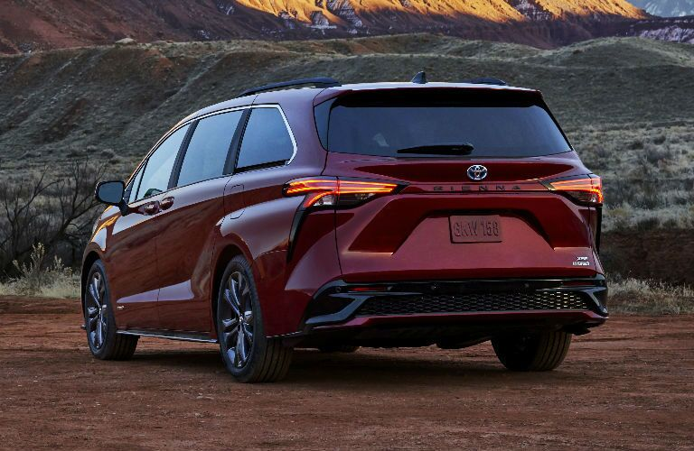 The rear exterior view of a red 2021 Toyota Sienna.