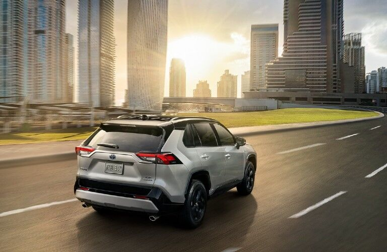 2021 Toyota RAV4 Hybrid driving toward city