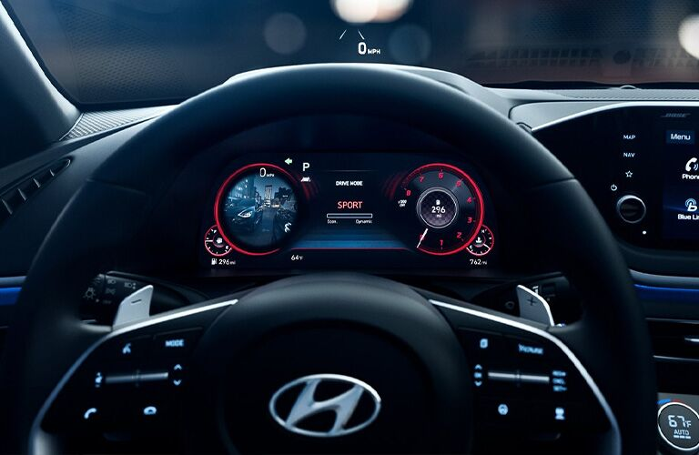 2021 Hyundai Sonata interior front cabin steering wheel close up with digital instrument cluster