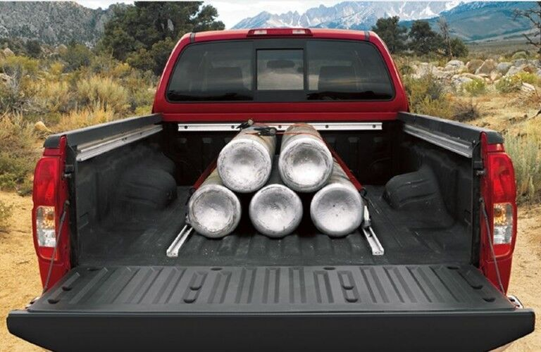 Rear bed of the 2020 Nissan Frontier with items in it