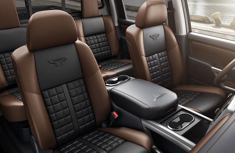 Seating arrangements and center console of 2018 Nissan Titan