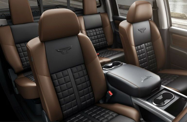 2018 Nissan TITAN XD crew cab seating with black and brown leather interior