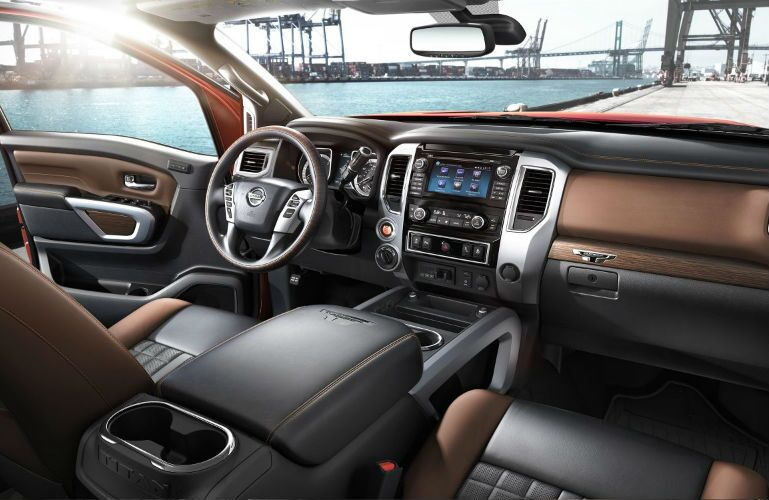 2018 Nissan TITAN XD front interior with view from rear seats in a crew cab