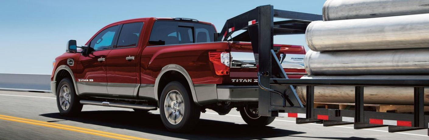2018 Nissan TITAN XD towing heavy metal pipes