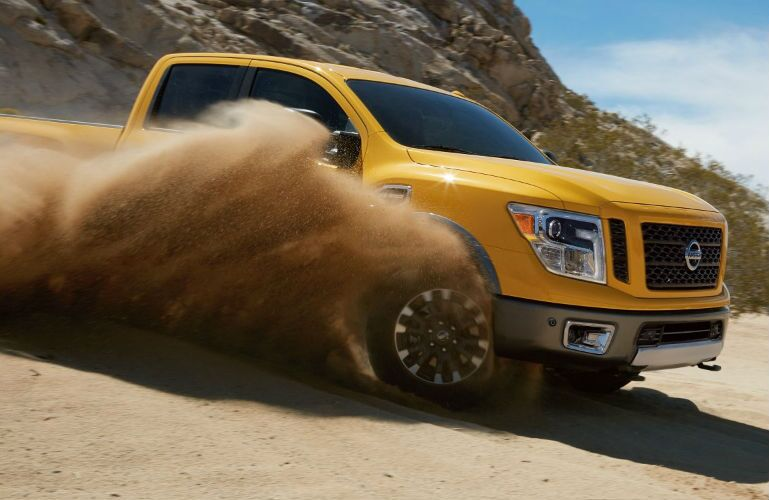 2018 Nissan TITAN XD driving off-road in sand