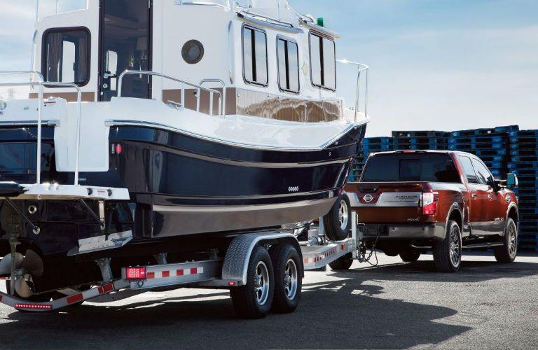 2018 Nissan TITAN XD towing a large boat do a dock