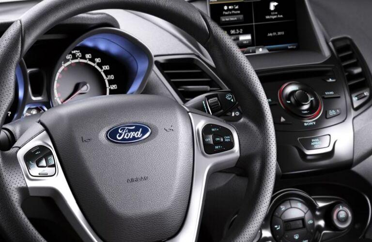 2014-ford-fiesta-interior-steering-wheel-instrument-panel-vs-chevy-sonic