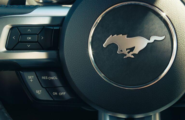 2015-ford-mustang-interior-steering-wheel-pony-emblem-vs-chevy-camaro