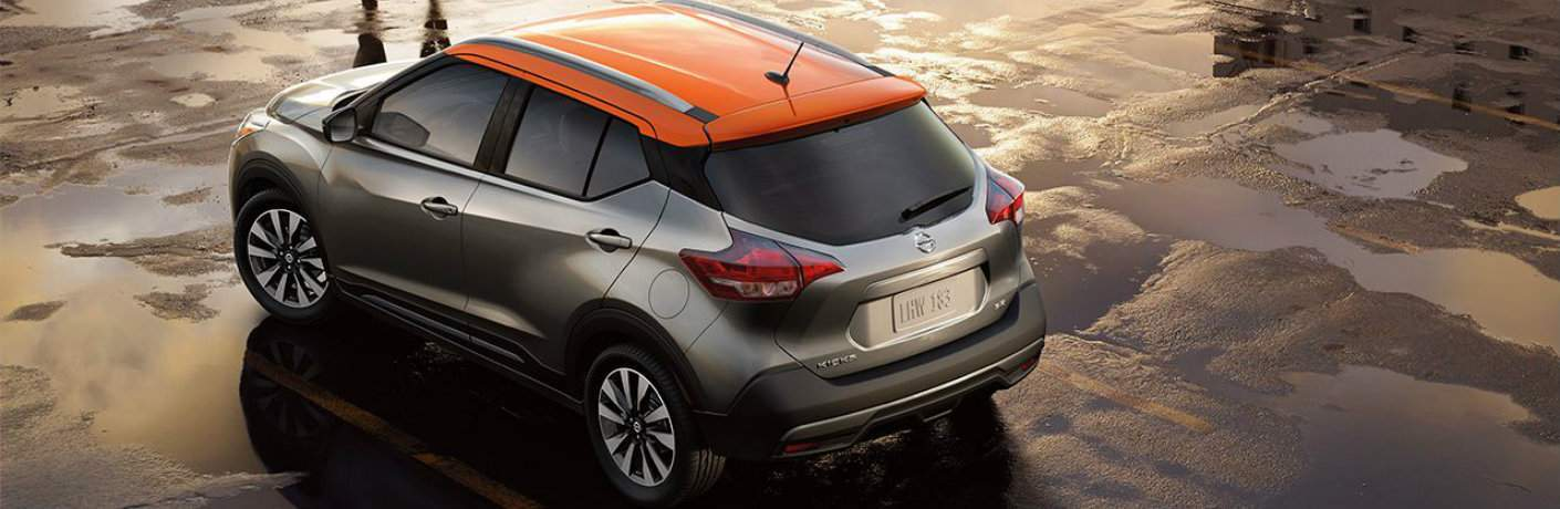 2018 Nissan Kicks parked in empty lot with two-toned roof prominently shown