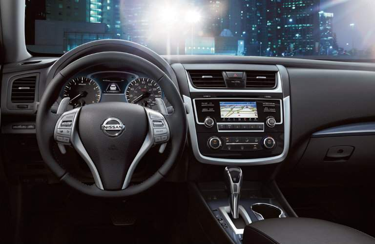 2018 Nissan Altima dashboard with steering wheel and touchscreen prominently shown