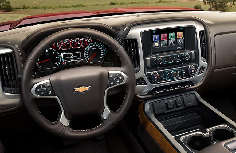 front interior of 2018 chevy silverado 3500hd including steering wheel, dashboard and infotainment system