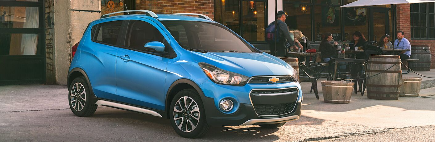 blue 2018 chevrolet spark parked on city street