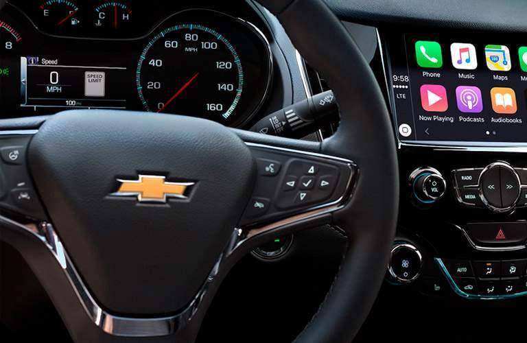 close up of the steering wheel controls inside the 2018 Chevrolet Cruze