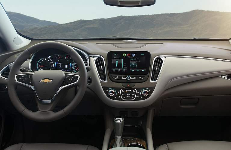 2018 Chevy Malibu interior front showing steering wheel, controls or infotainment system