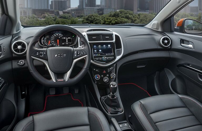 front interior of 2018 chevy sonic including steering wheel and infotainment system