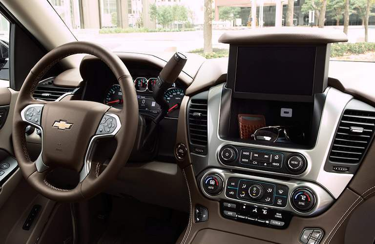 detail image of the front of the 2018 Chevrolet Suburban with its controls and storage shown