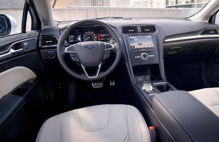 driver-side interior of 2018 ford fusion hybrid including steering wheel and dashboard