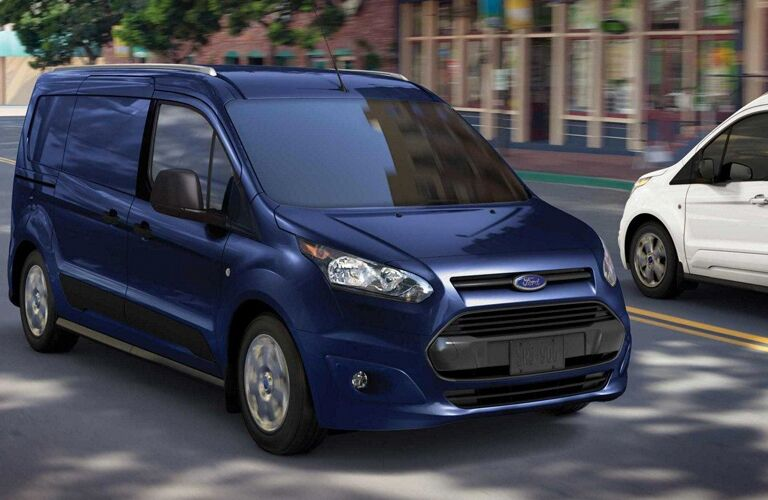 blue 2018 ford transit connect van driving in city