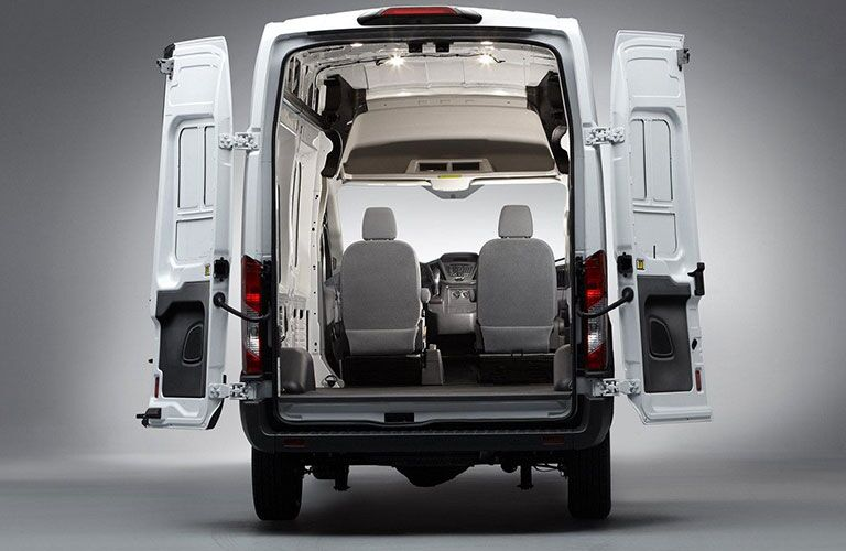 rear view of white 2018 ford transit cargo van with cargo doors open showing inside