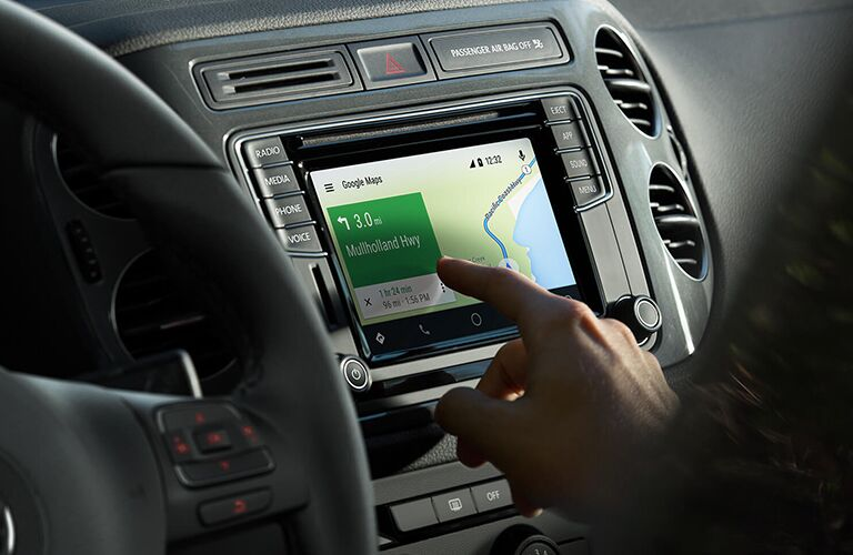 person using the 2018 volkswagen tiguan integrated navigation system