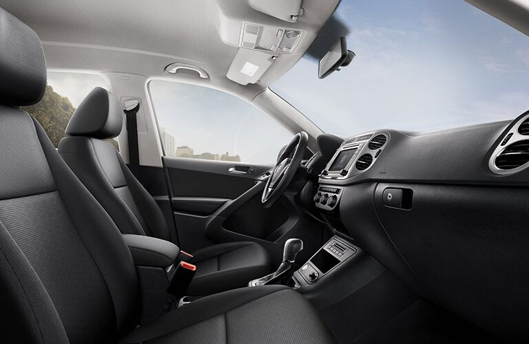side view of front interior of 2018 volkswagen tiguan limited including seats and center console